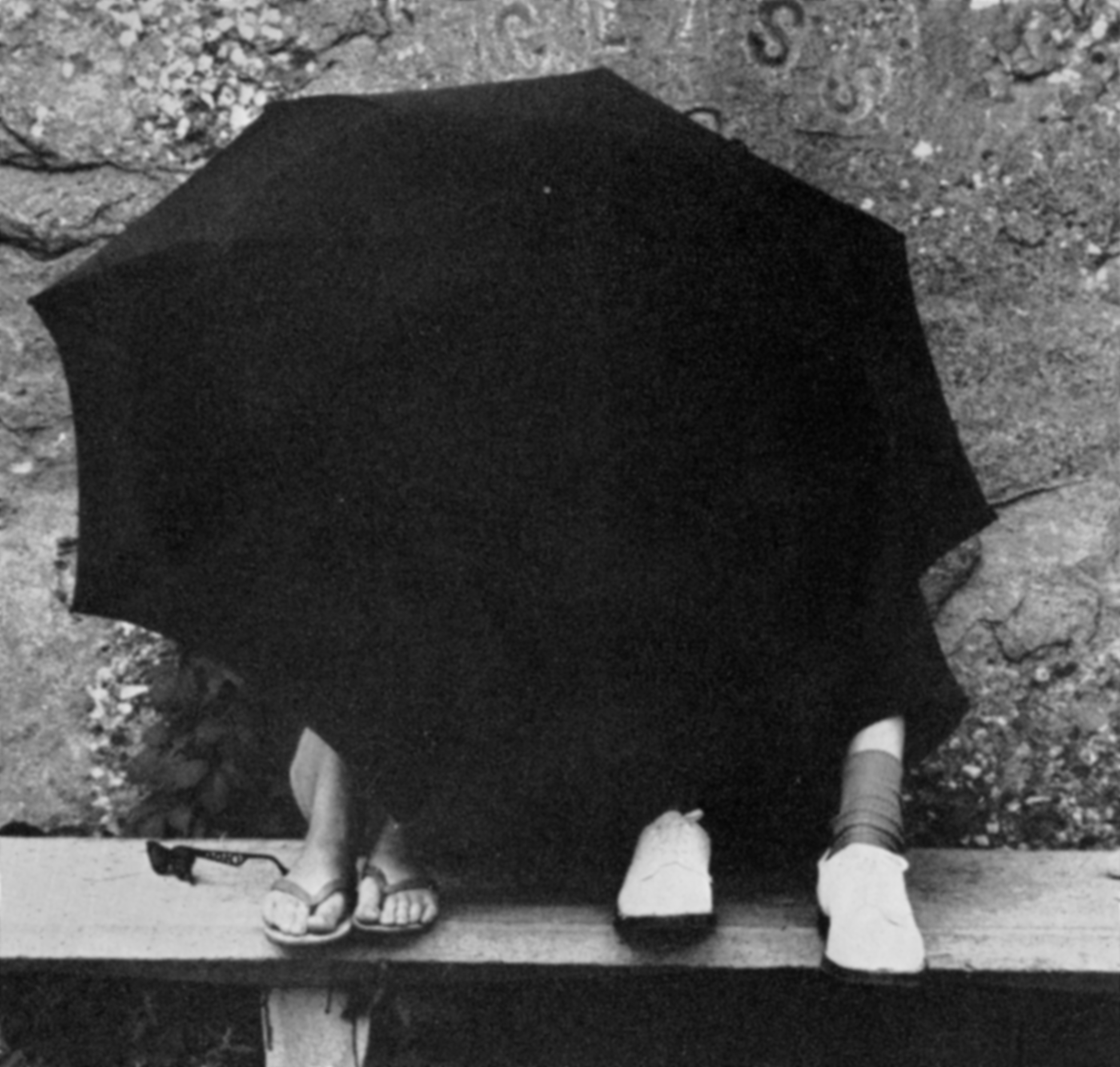 Students Hiding behind Umbrella in front of the Rock, circa 1962