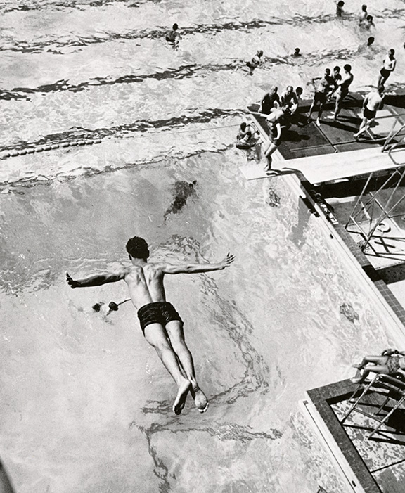 Male student diving into pool 1965