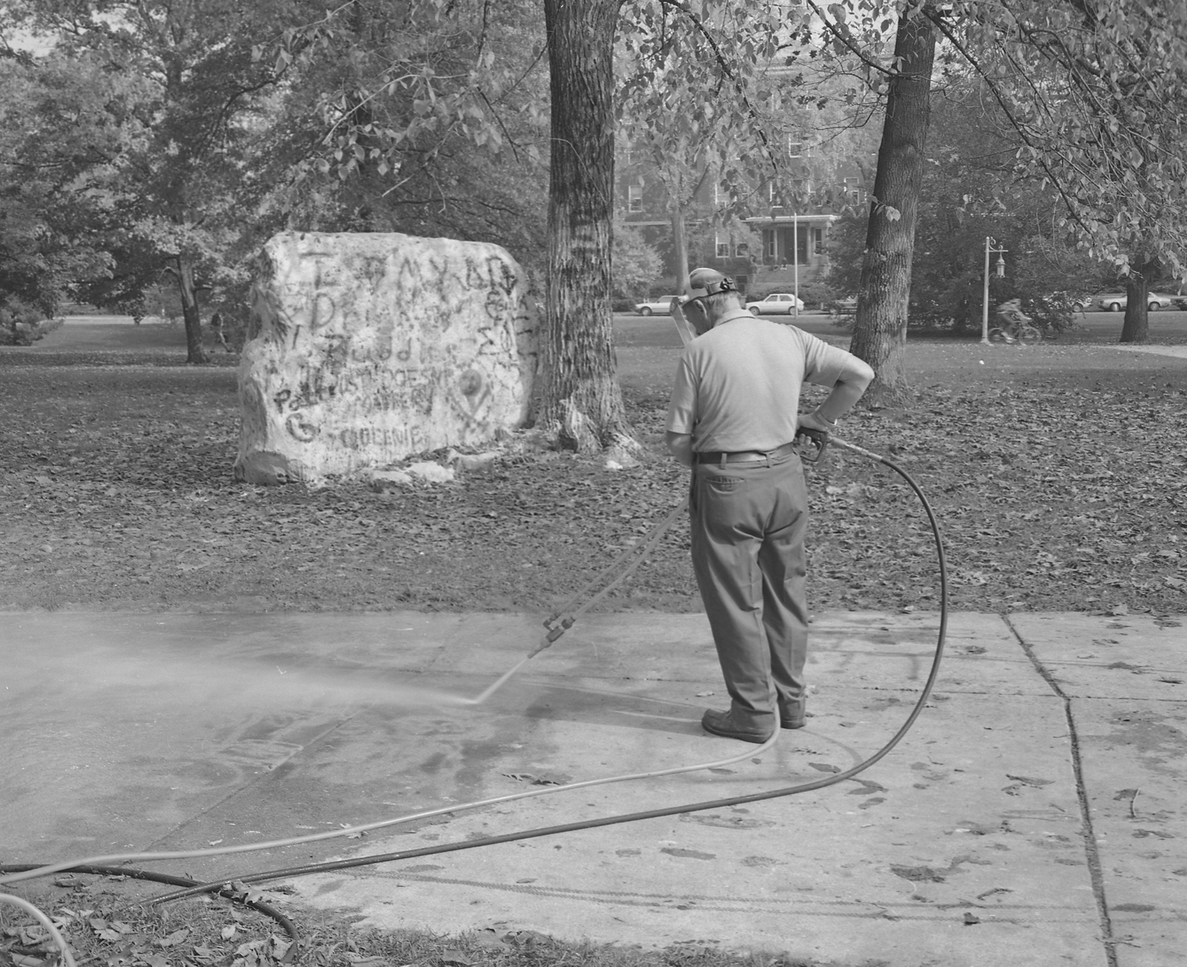 Sidewalk being cleaned next to the Rock, October 16, 1984