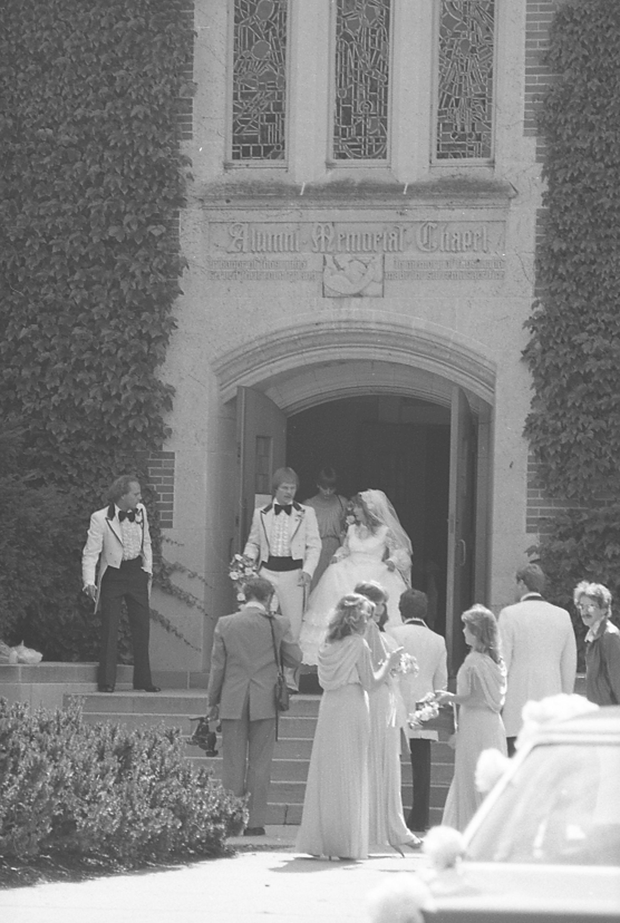 Bride and groom exiting Alumni Chapel; September 29, 1981