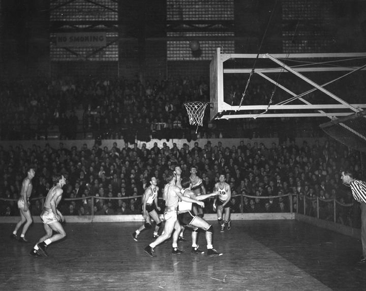 Basketball Players Looking Up at the Ball