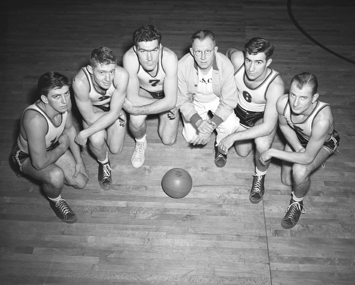 Basketball Players Kneeling with Coach