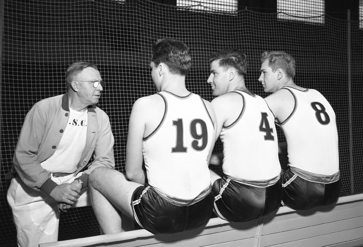 Coach talking with Basketball Players