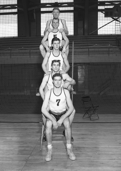 Basketball Players Sitting/Standing in a Row