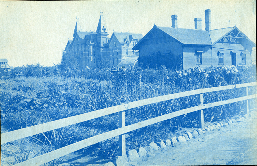 03. Campus view of a field, greenhouse and Wells Hall (I), circa 1888.