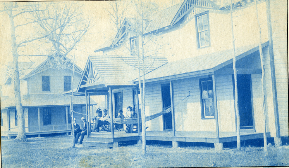 05. People sitting on the porch of a house or cottage, circa 1888.