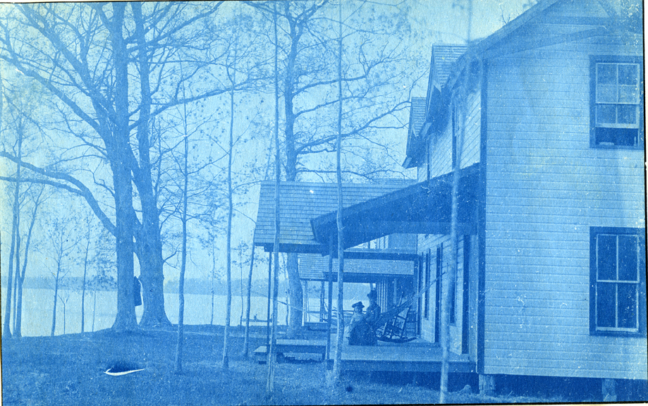 09. Woman and child sitting on the porch, circa 1888.