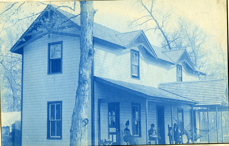 19. People on the porch of a house or cottage, circa 1888.