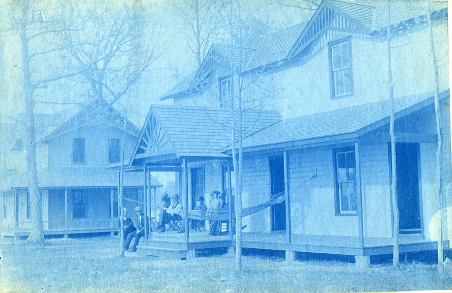 45. People sitting on the porch of a house, circa 1888.