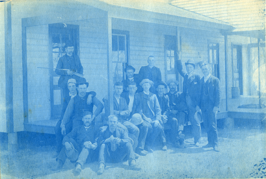 53. A group of men sitting on the porch of house, circa 1888.