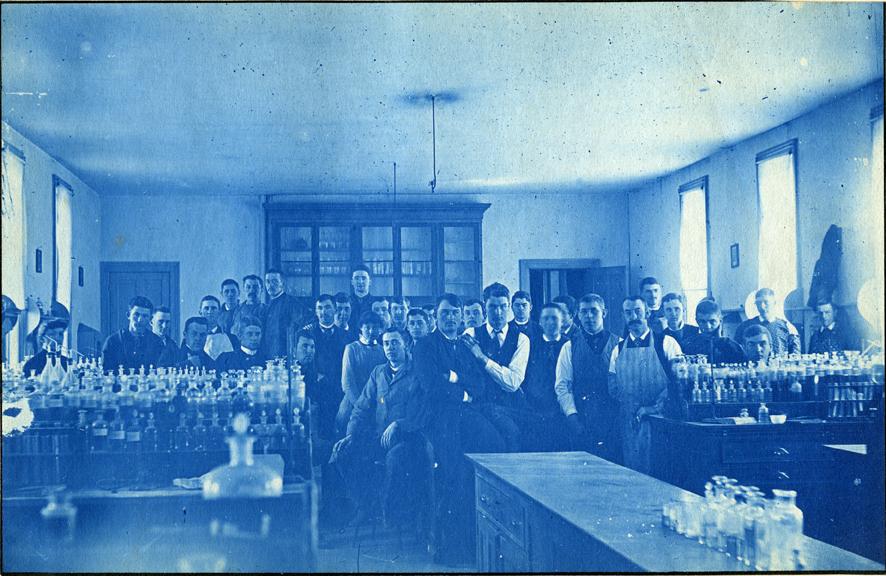 56. Students posing in a laboratory classroom, circa 1888.