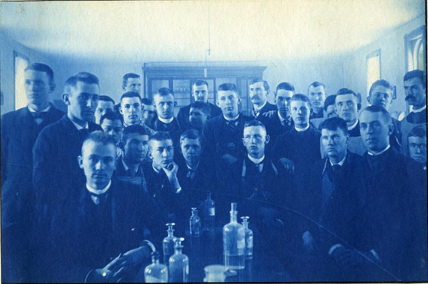 69. Students pose in a laboratory classroom, circa 1888.