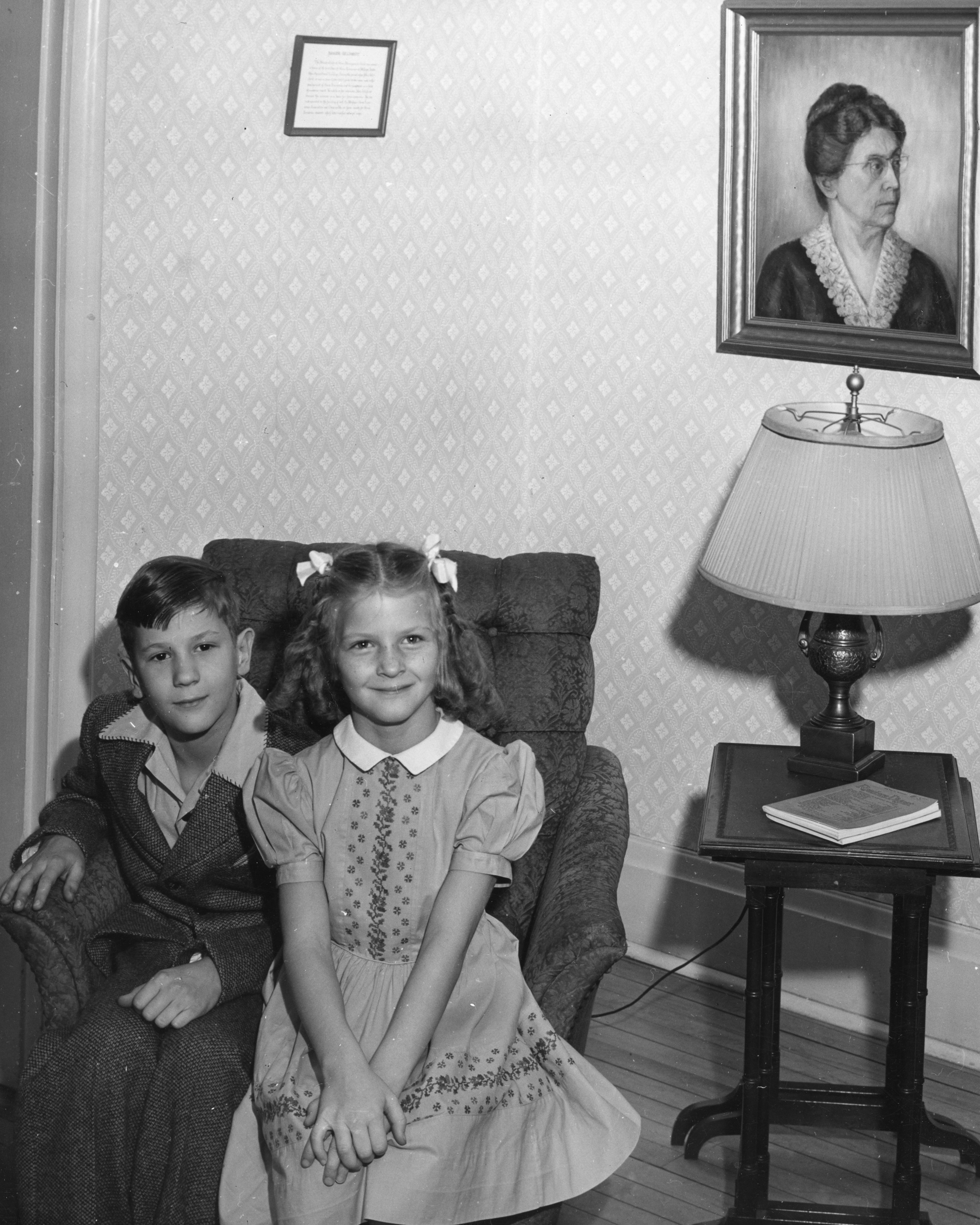 Frank and Margaret Thorp as children sitting on a chair, ca. 1940s