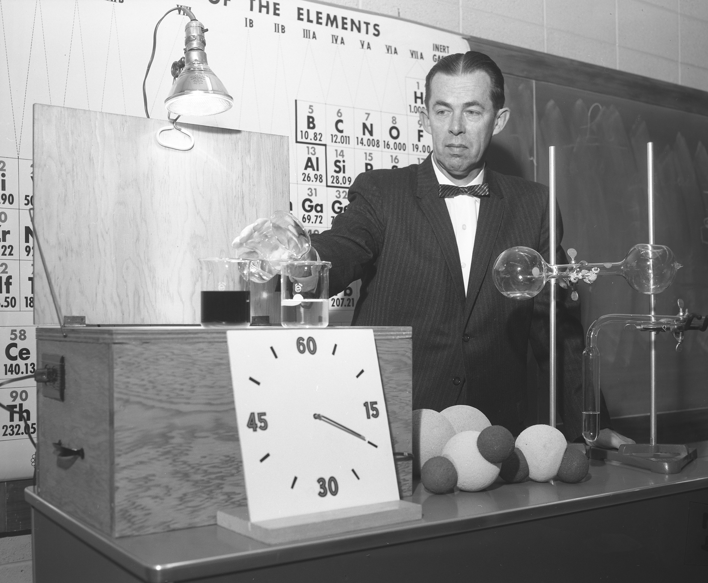 Dr. Frederic B. Dutton with chemical apparatus, 1960