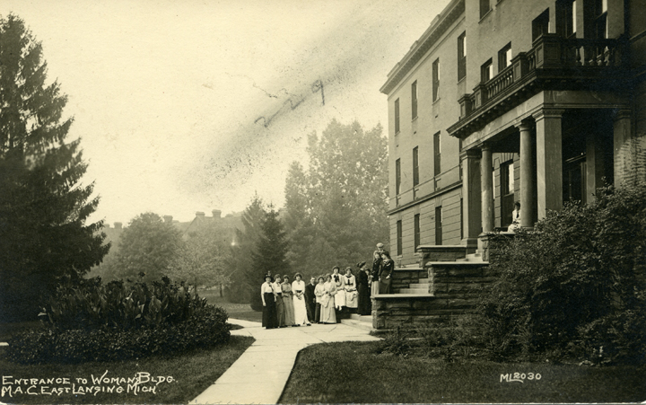 A group of women standing in front of Morrill Hall