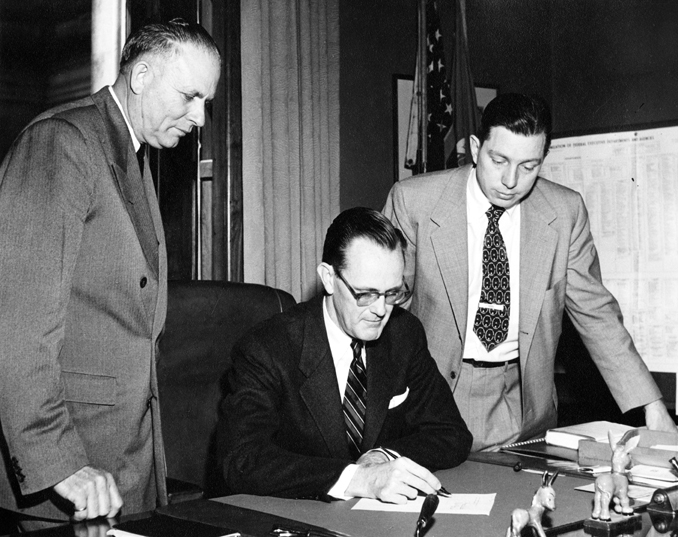 John Hannah Observes signing of the Michigan State University Bill, 1955