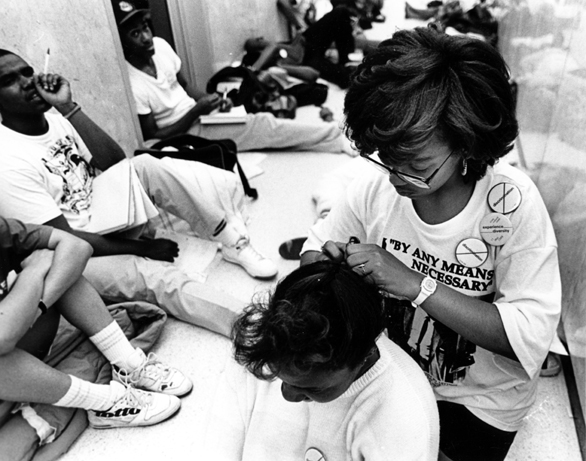 Female student styles hair of another student during the 1989 Hannah Building occupation