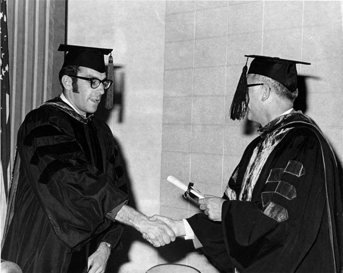 Lance E. Olson receives certificate
