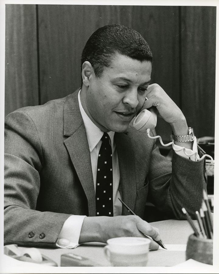 Clifton Wharton in his office, 1970