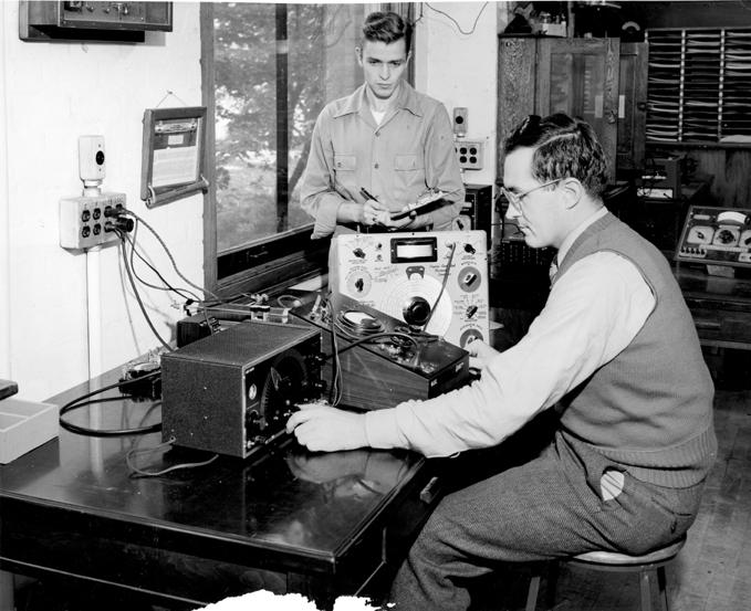 Engineering students calibrating a signal generator, 1947