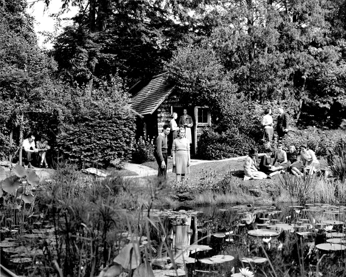 Students sit near a pond in the Beal Botanical Garden, 1940's
