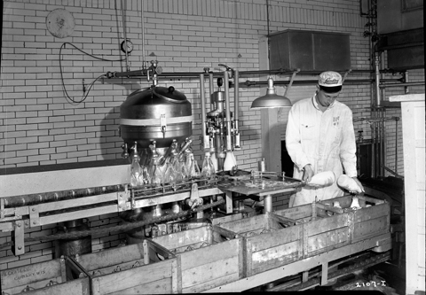 Dairy Worker with Bottled Milk