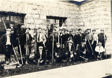 A groups of students with surveying equipment, 1913
