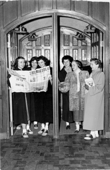 Female students reading a newspaper, ca. 1949