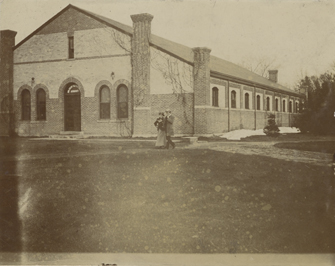 A couple walks past the Armory building