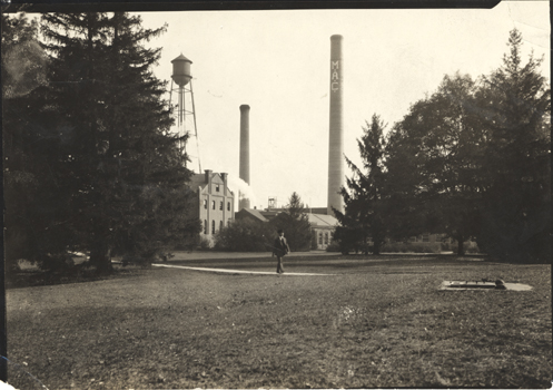 M.A.C. Smokestacks and power buildings on campus, 1920 ca.