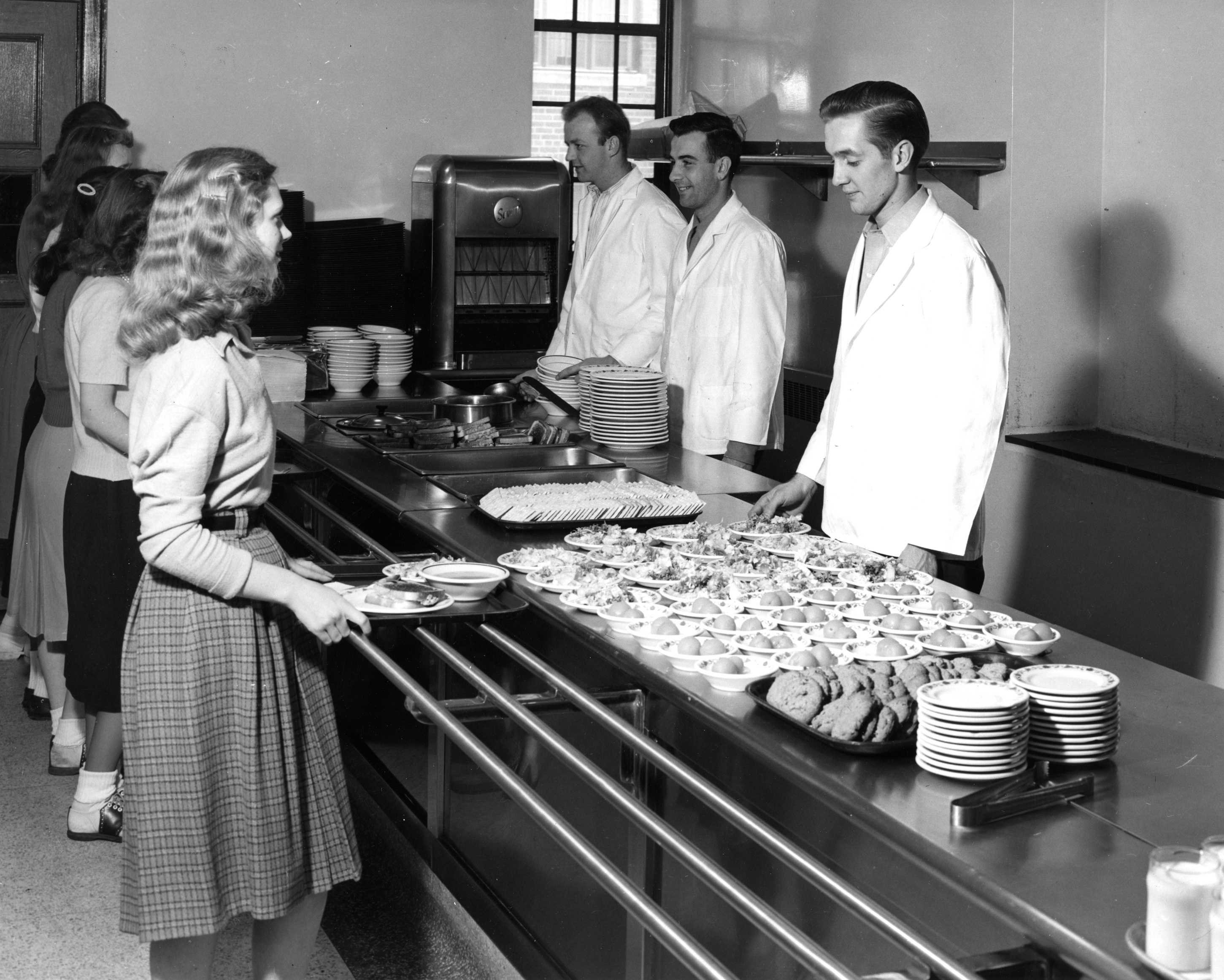 Students in the cafeteria serving line at Landon Hall, 1948