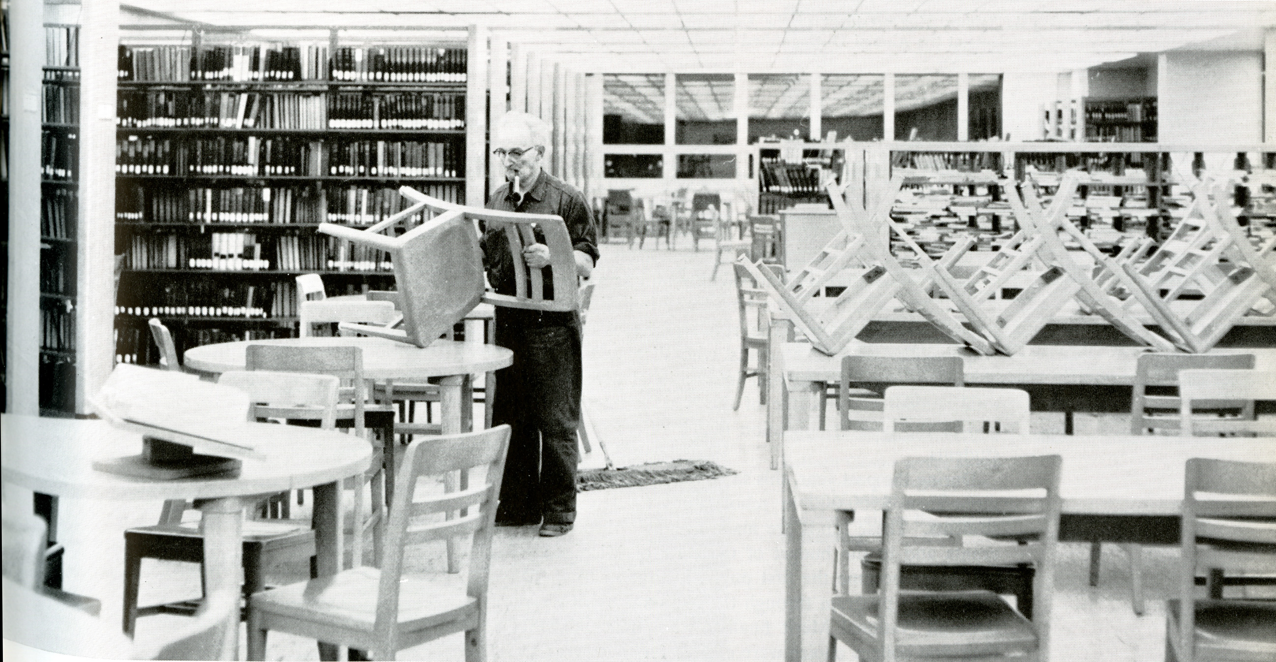 Man cleaning the library