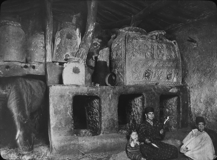 Algerian mother and children in home or stable, undated