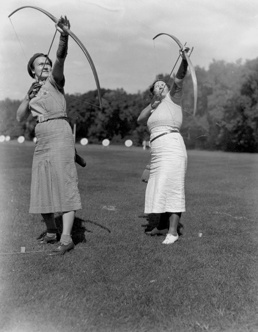 Two women practicing archery, 1937