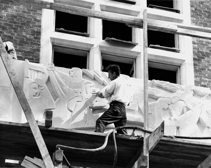 An artist works on the Union Building, 1948