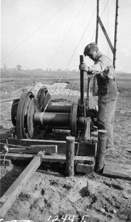Farm machinery demonstration, date unknown