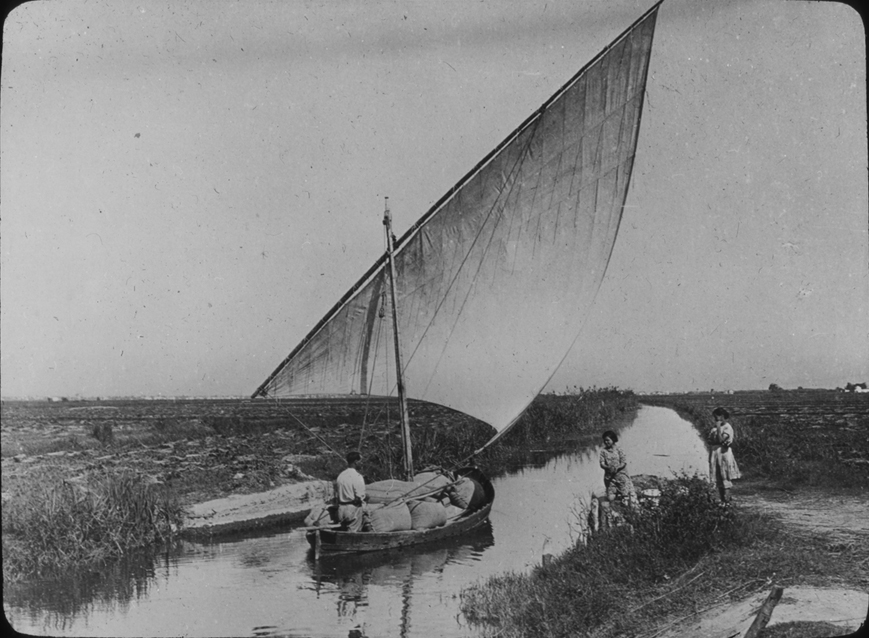 Sailboat with products on rural Spanish river, undated