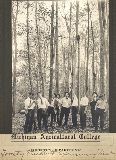 Forestry students examining timber, date unknown
