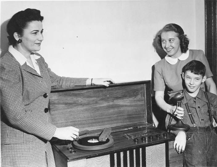 Child recording on a record, date unknown