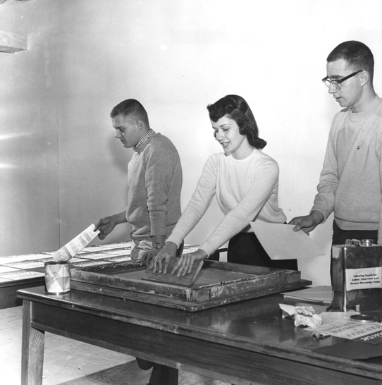 The yearbook staff make signs, 1958