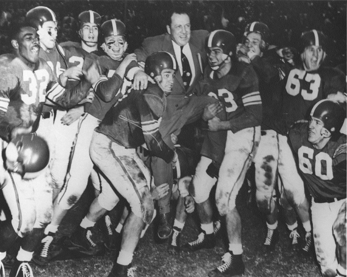Players lift Coach Munn after the Rose Bowl, 1954