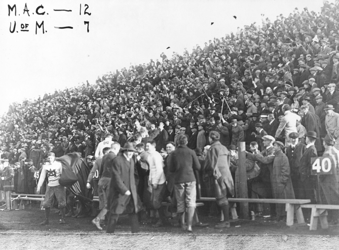 Fans at a football game, 1913
