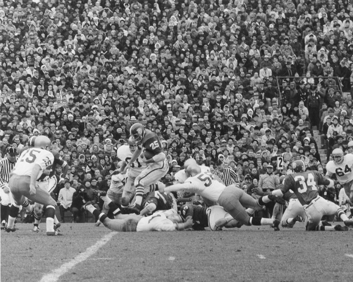 Stadium and players at a football game, 1966