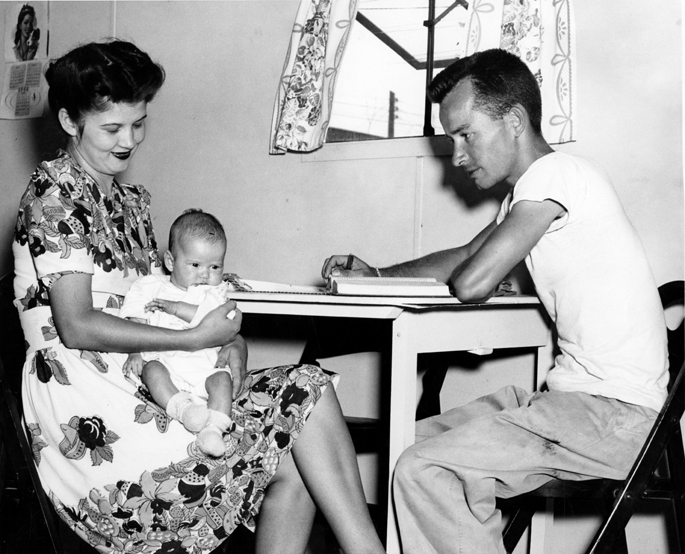 Student studying with wife and baby, 1946