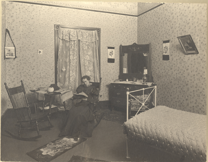 Female student studying in Abbot Hall, circa late 1890s