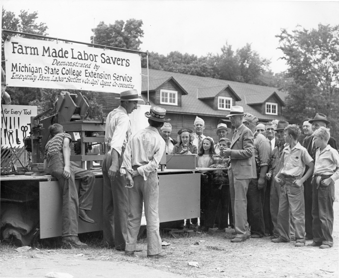 Farmers look at new tools, date unknown