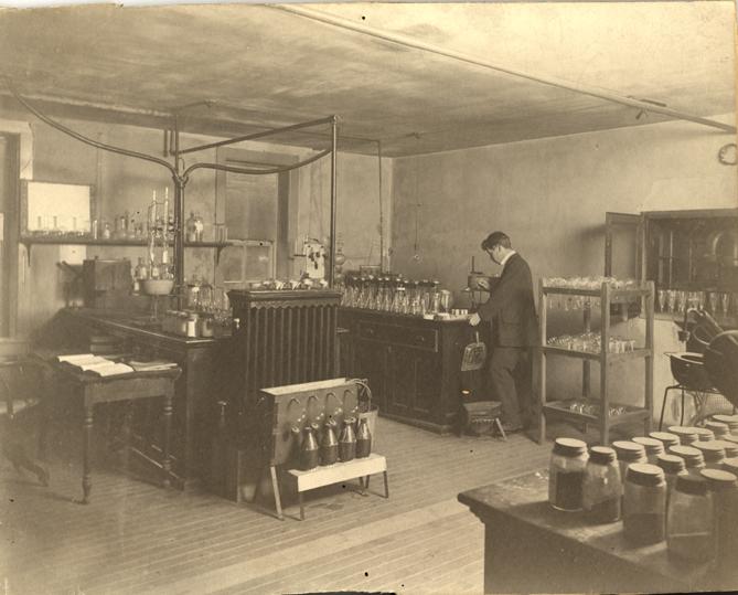 Chemist working on fertilizer tests, 1897