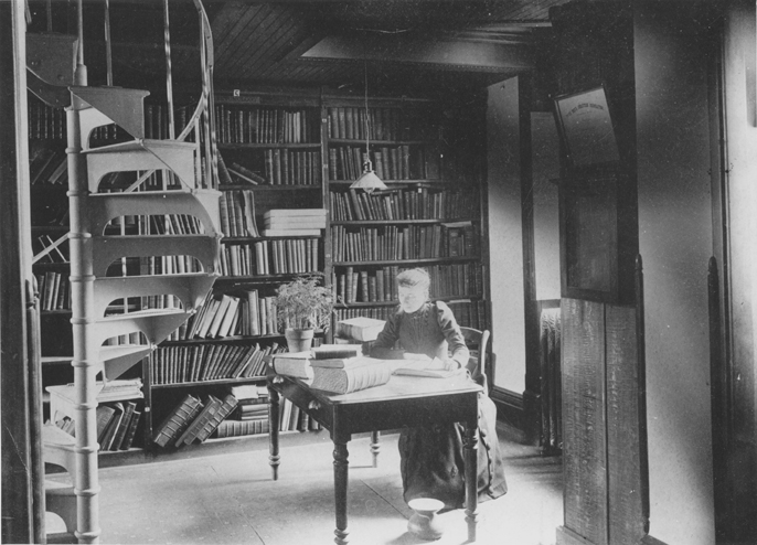Miss Landon in Linton Hall library, date unknown