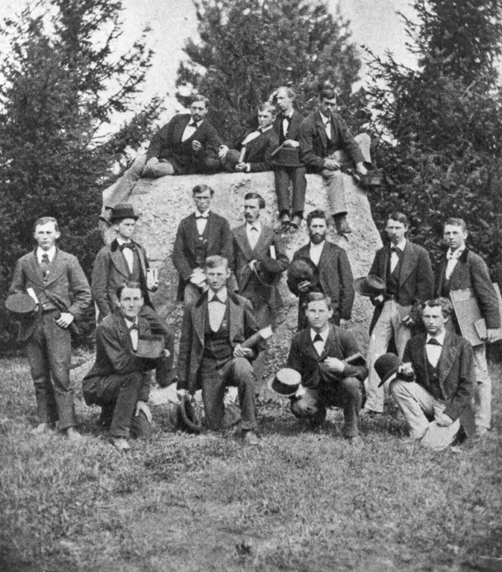 Students pose for a picture by the Rock, circa 1875