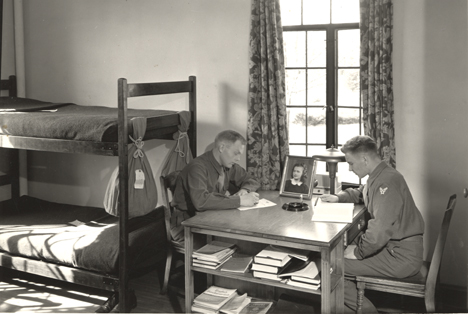 Two Army trainees studying, ca. 1940